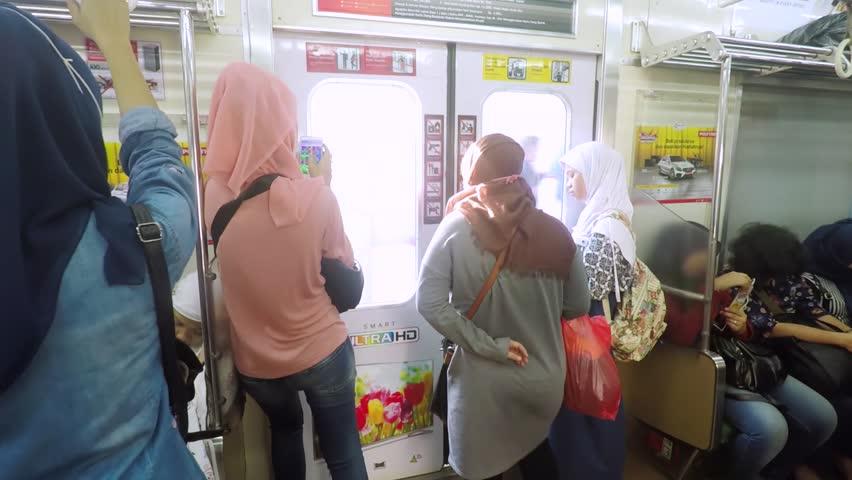 JAKARTA, Indonesia. September 20, 2017: Crowded female passengers walking through doorway in women exclusive train | Shutterstock HD Video #30933445