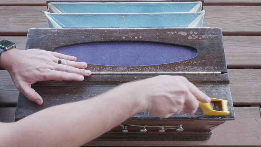 This is a shot of someone using a wood Shaver on an old harmonium or Pump Organ Shot on a GH5 with 8-18mm leica