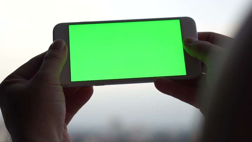 Woman hands typing sms scrolling pictures mobile phone background 4K green screen | Shutterstock HD Video #30947305