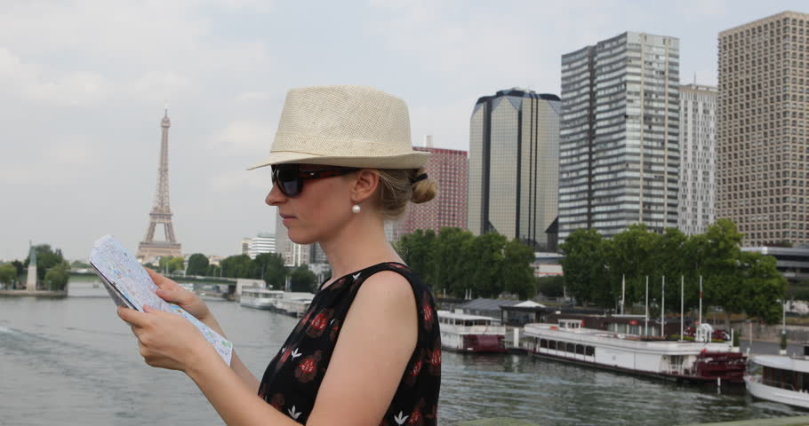 Pan Left Of Tourist Woman Search Direction In Paris City Map, Eiffel Tower And Seine River | Shutterstock HD Video #30967624