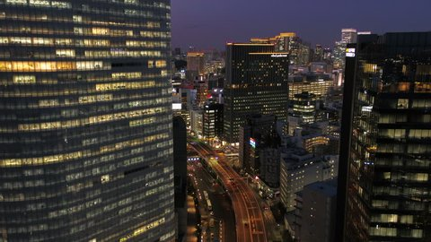 Japan Tokyo Aerial v146 Flying low over Hamarikyu park with Ginza cityscape views dusk 2/17