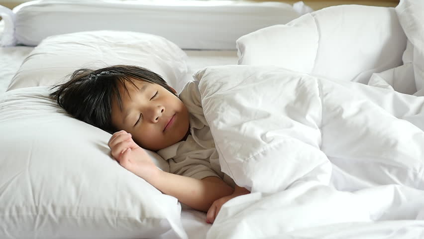 Cute Asian child sleeping on white bed with mother care slow motion | Shutterstock HD Video #30988525