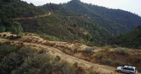 Aerial following subaru forester driving down dirt road on Figueroa Mountain in Santa Barbara.