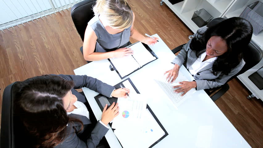 Diverse women focusing on future benefits in office | Shutterstock HD Video #3099265