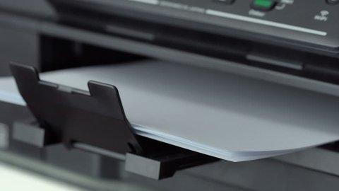 Closeup shot of Printing document paper with inkjet printer
