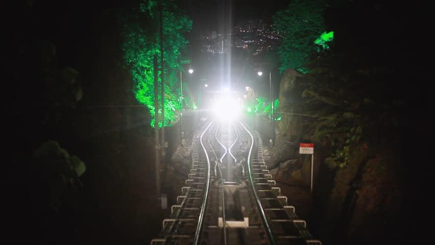 Modern driver-less metro train rush forward, along night Malaysia, Overground railway, bright road lights at night. 1920x1080 | Shutterstock HD Video #31010458