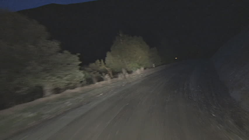Driving POV shot, Mendocino National Forest, Bartlett Springs Road, dirt, at night.