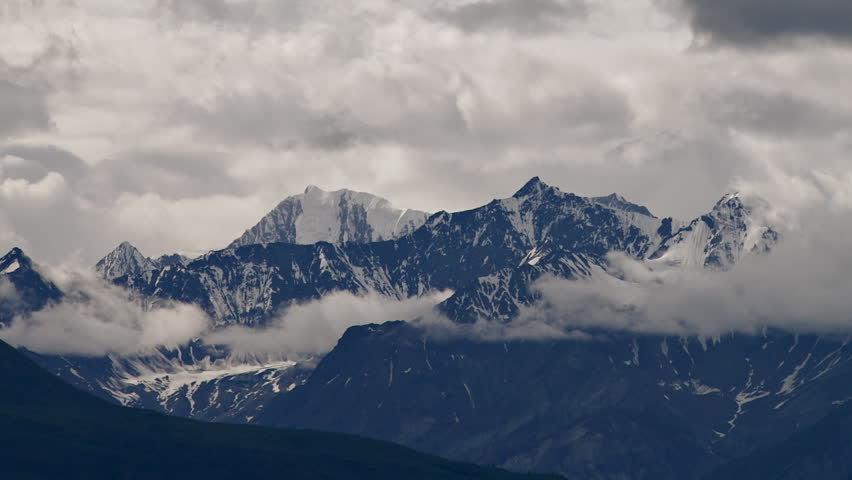 Time lapse of wickedly intense clouds roiling and flowing over peaks of the Chugach Mountain Range near Matanuska Glacier east of Palmer, Alaska.