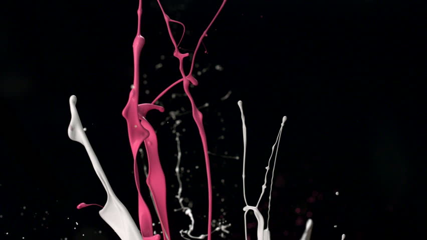 White and pink paint splash in the air shooting with high speed camera, phantom flex.