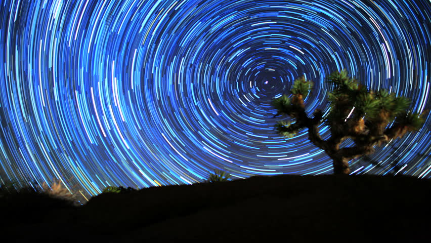 Star Trail Galaxy Spins Behind Joshua Tree in Stunning Night Desert Timelapse