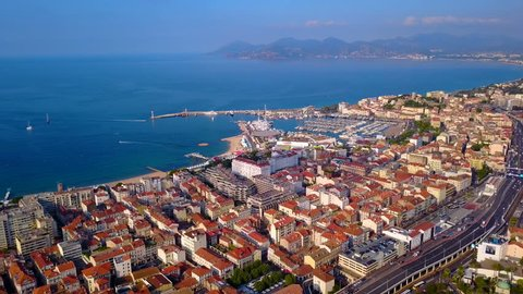 Cannes Aerial. Flying over downtown and coastline.France, Cannes, Aerial view of the Croisette. Canees harbor