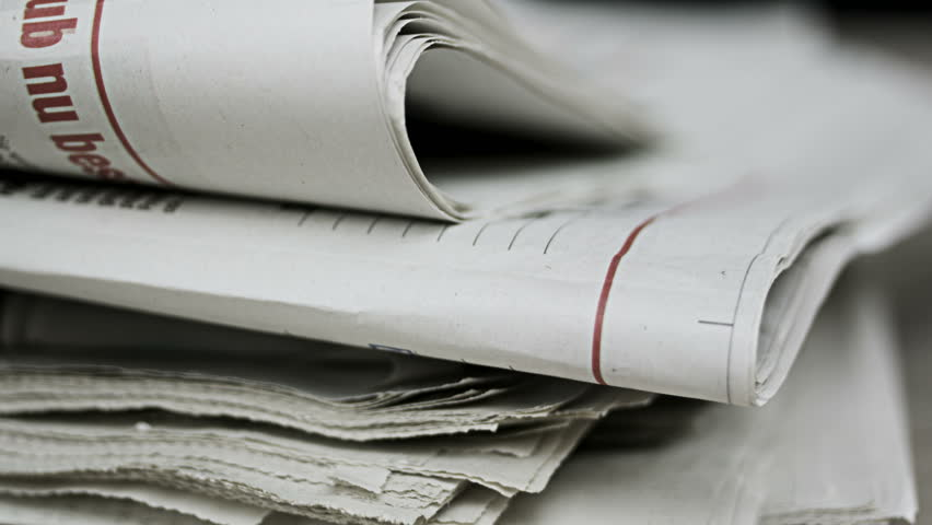 Close up shot of newspapers piling up | Shutterstock HD Video #31089505