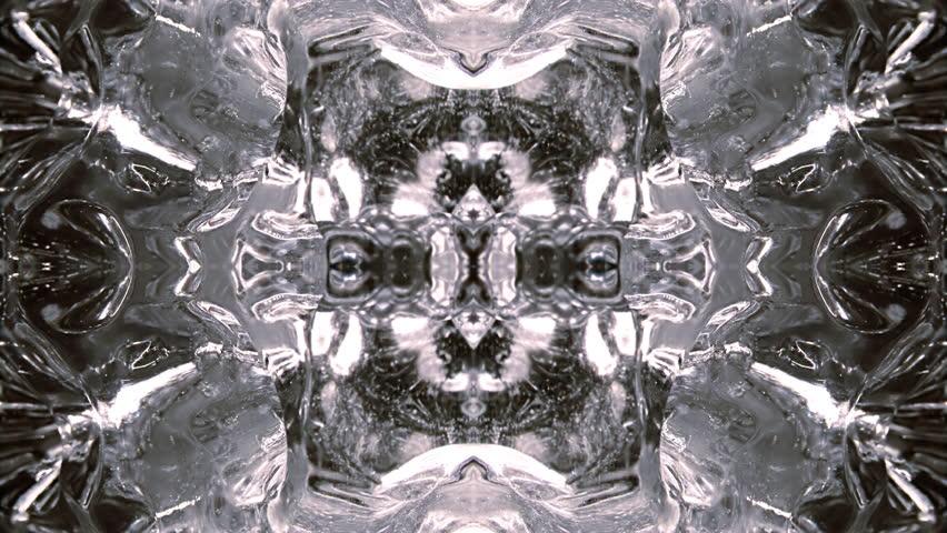 Rotating close-up, in kaleidoscopic quad pattern. Folding in. Based on strange