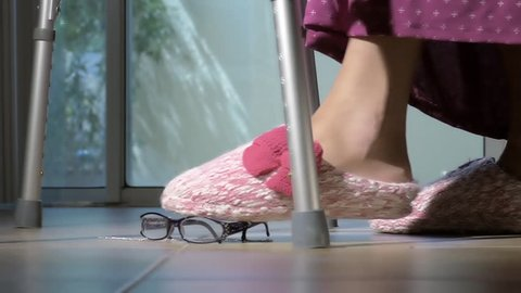 Elderly old woman feet slipping and falling down closeup