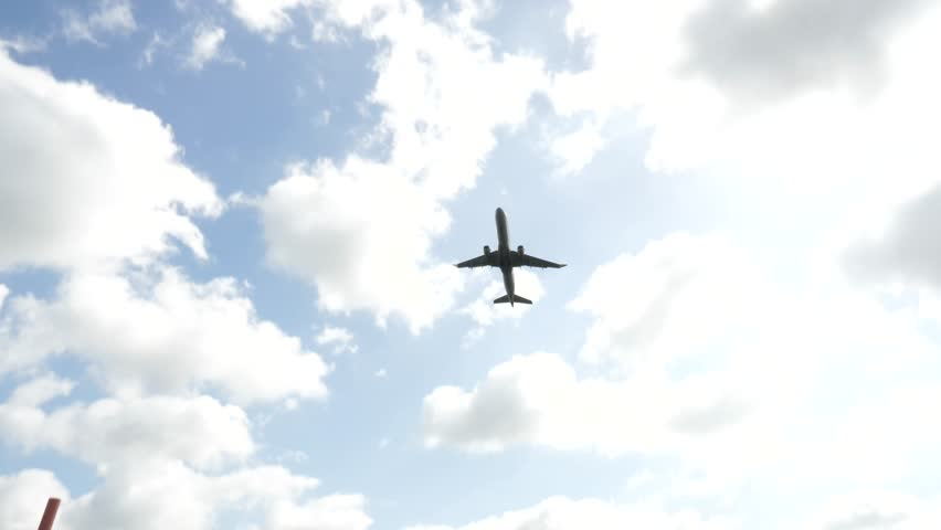 Looking Up at Airplane Taking off with Blue Skies Close Slow Motion