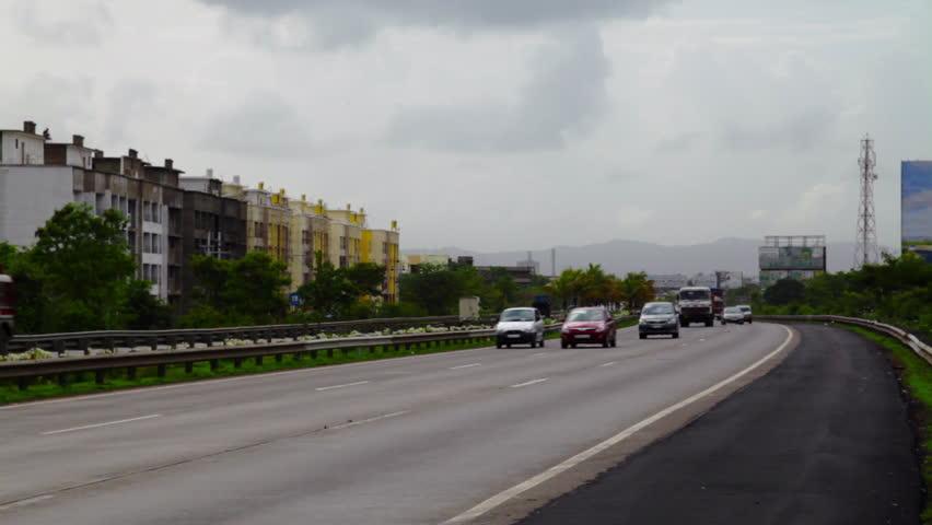 Locked-on shot of traffic moving on the highway, Mumbai Pune Expressway, Mumbai, Maharashtra, India