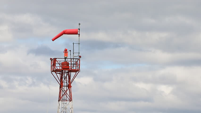 Windsock Tower and Cloudy Sky