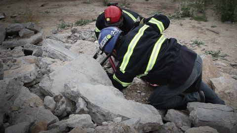 Paramedics helping survivor under the rubbles