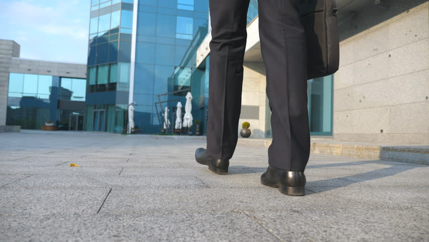 Business man commuting to work. Confident guy in suit being on his way to office building. Young businessman with a briefcase walking in city. Slow motion Rear back view Close up | Shutterstock HD Video #31194895