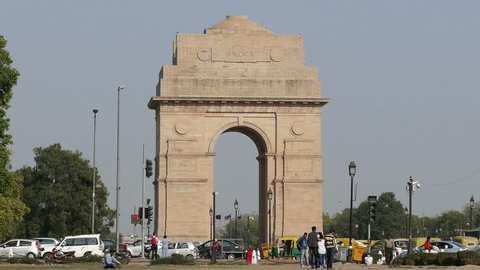 NEW DELHI, INDIA - MARCH, 2017: tourists visit to India Gate on March, 2017. India Gate was built to memorialize the Indian soldiers who lost their lives during the First World War.