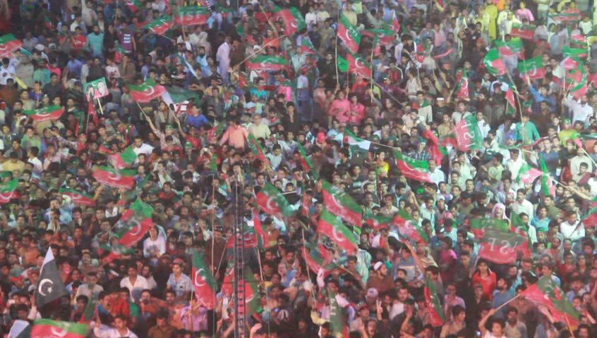 SIALKOT, PAKISTAN - MAR 23: Massive crowd support for cricket turned politician Imran Khan during a political rally at Jinnah Cricket Stadium on March 23, 2012 in Sialkot, Pakistan #3122995