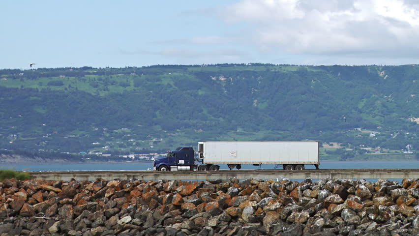 Semi Truck Hauling Goods and Fish From Dock