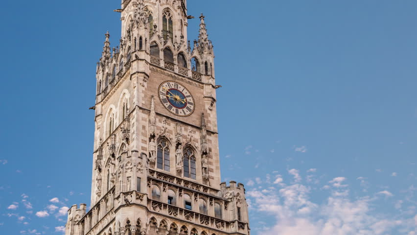 The New Town Hall (Neues Rathaus) clock tower located on Marienplatz, the central Munich sqaure. Gothic architecture.