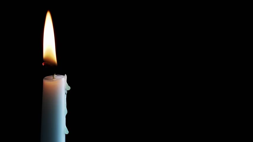 Loop with single simple white candle and flickering flame against a black background with excellent text space. Filmed at 1920x1080p HD widescreen resolution.