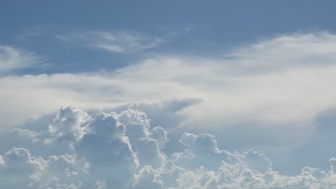 Fluffy white clouds aerial shooting in rain day, nice clear weather & blue sky. Puffy fluffy white clouds blue sky time lapse motion background. Bright blue sky puffy fluffy white cloud cloudscape.