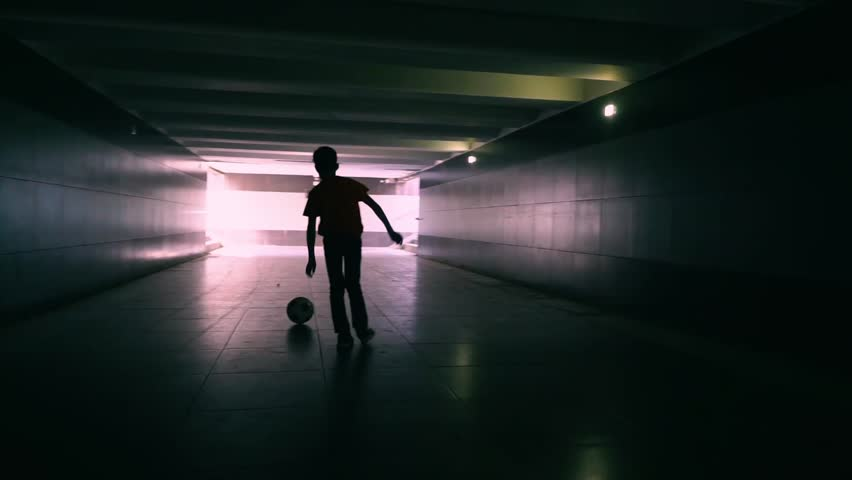 The Boy In The Underground Passage Plays With A Soccerball