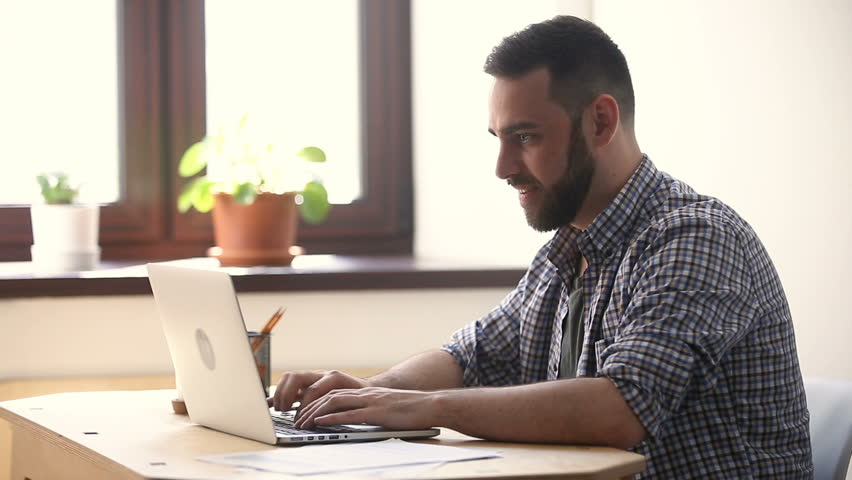 Happy man feels excited about win online, winner looking at laptop showing yes gesture, celebrating success, internet casino betting luck, achieved goal, good news on web, enjoying triumph, did it | Shutterstock HD Video #31313965