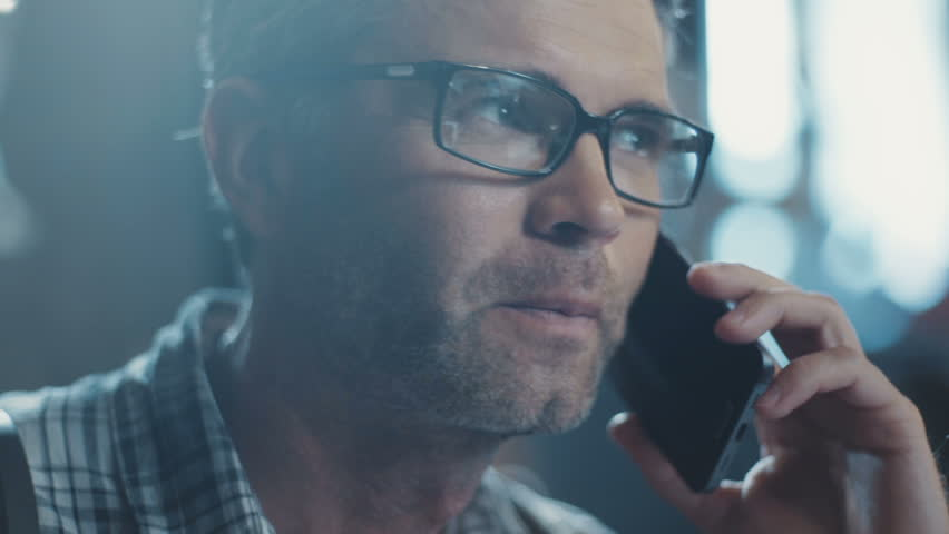 The man in his glasses speaks on the phone fluttering the book interior design. Something is looking for. Design Business. Enthusiastic. Design, abstract. Shot on RED Epic Camera.   Shutterstock HD Video #31330261