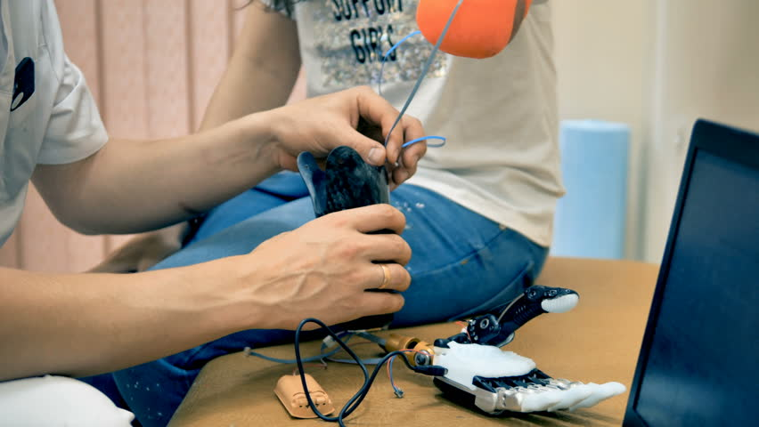 Woman using adjustable robotic prosthetic for the first time.