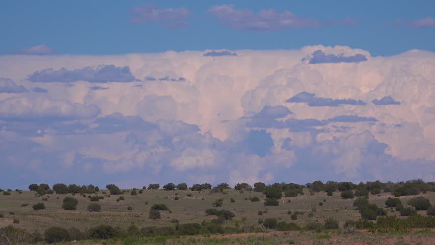 CIRCA 2010s - New Mexico - Beautiful walls of thunderheads and storm clouds move across the New Mexico desert.