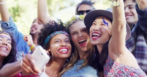 Portrait of Caucasian, Asian and mixed race female friends having fun at music festival 4k