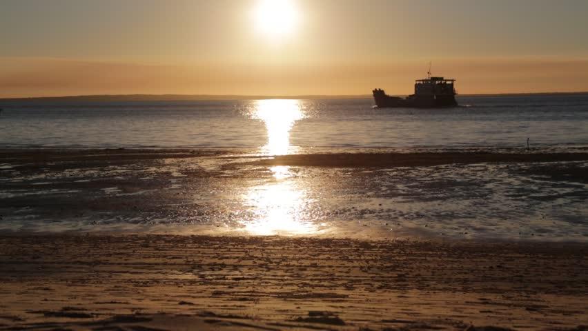 AUSTRALIA,HERVEY BAY-CIRCA  AUGUST 2017-unidentified boat in the ocean sunrise   | Shutterstock HD Video #31389298