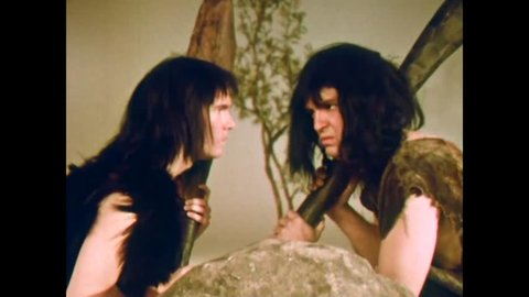 CIRCA 1960s - A strange renactment of cavemen inventing communication ends with sore fet'