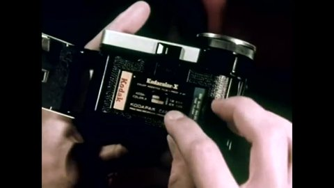 CIRCA 1960s - Flashcubes for a Kodak Instamatic Camera are used as photos are taken in a psychedelic nightclub filled with dancing partiers, in a television commercial, in 1965.