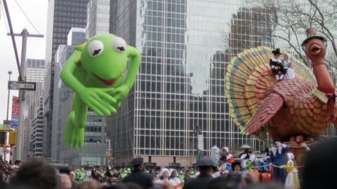 NEW YORK - NOV 26: Macy's Thanksgiving Day Parade Balloons with Kermit the Frog balloon and Thanksgiving turkey balloon on November 26, 2009 in New York, NY.