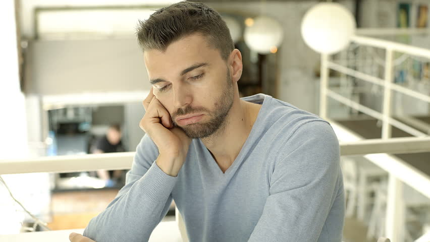 Handsome man in blue sweater doing worried look to the camera in the cafe, steadycam shot  | Shutterstock HD Video #31431325