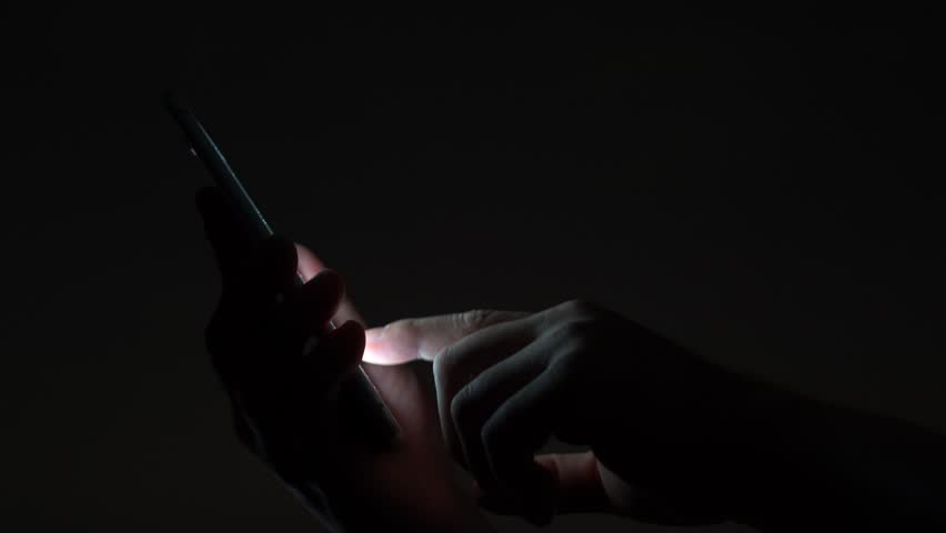 Woman Using Her Mobile Phone In The Street, Night Light Background   4K  Stock Footage
