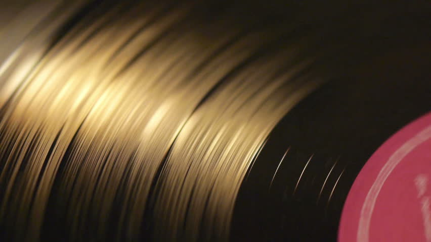 A Spinning Vinyl Phonograph Record Close Up 4 Colors Stock