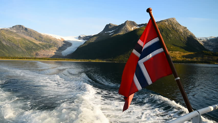 Norways flag on the ferry trough Arhaugfjorden to the Svartisen glacier, Holandsfjord, Norway, Scandinavia, Europe.