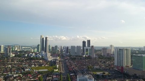 Aerial view of Johor Bahru City with tall buildings in the clear sky afternoon
