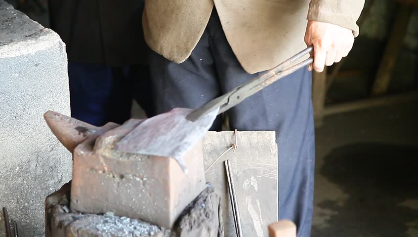 Stock Video Clip Of A Blacksmith In China Using Modern
