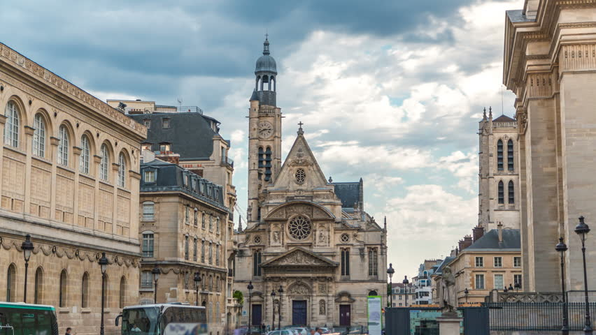 Church of Saint-Etienne-du-Mont timelapse in Paris near Pantheon. It contains shrine of St. Genevieve - patron saint of Paris. Church also contains tombs of Blaise Pascal Jean Racine. Cloudy sky at