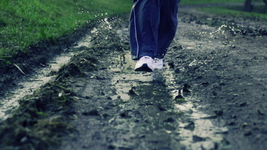 Jogger legs running through puddle, super slow motion, shot at 480fps