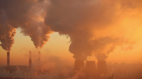 Polluting factory at dawn, time-lapse
