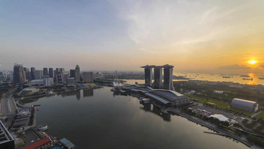Beautiful Aerial Time lapse of Day to Night of Singapore skyline with reflection. 4K UHD.