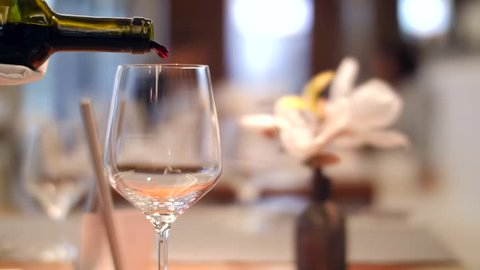 Pouring red wine in slow motion